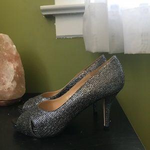 Kate spade silver shoes.